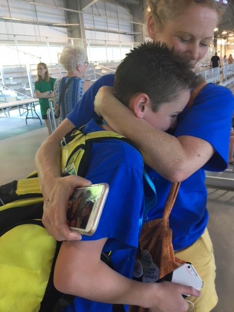 Alex Divers hugs his mom.